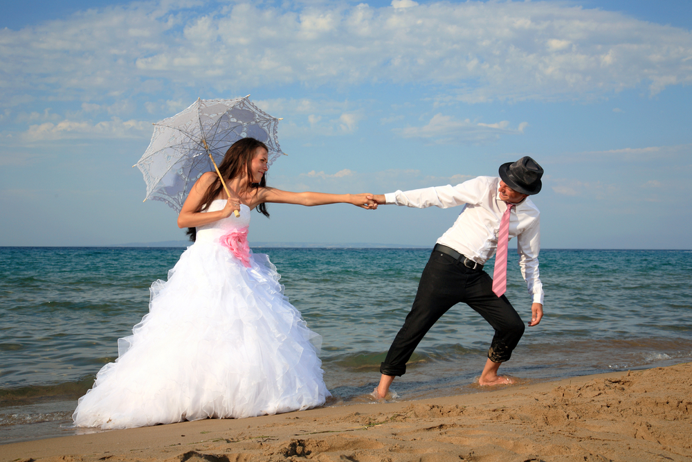 wedding_couple_on_the_beach_shutterstock_146781929.jpg
