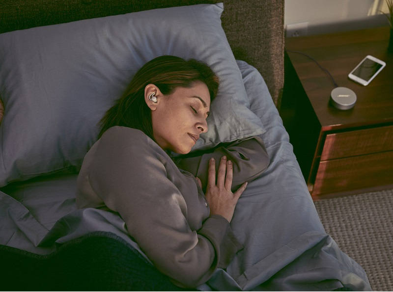 Image of women sleep with earbuds
