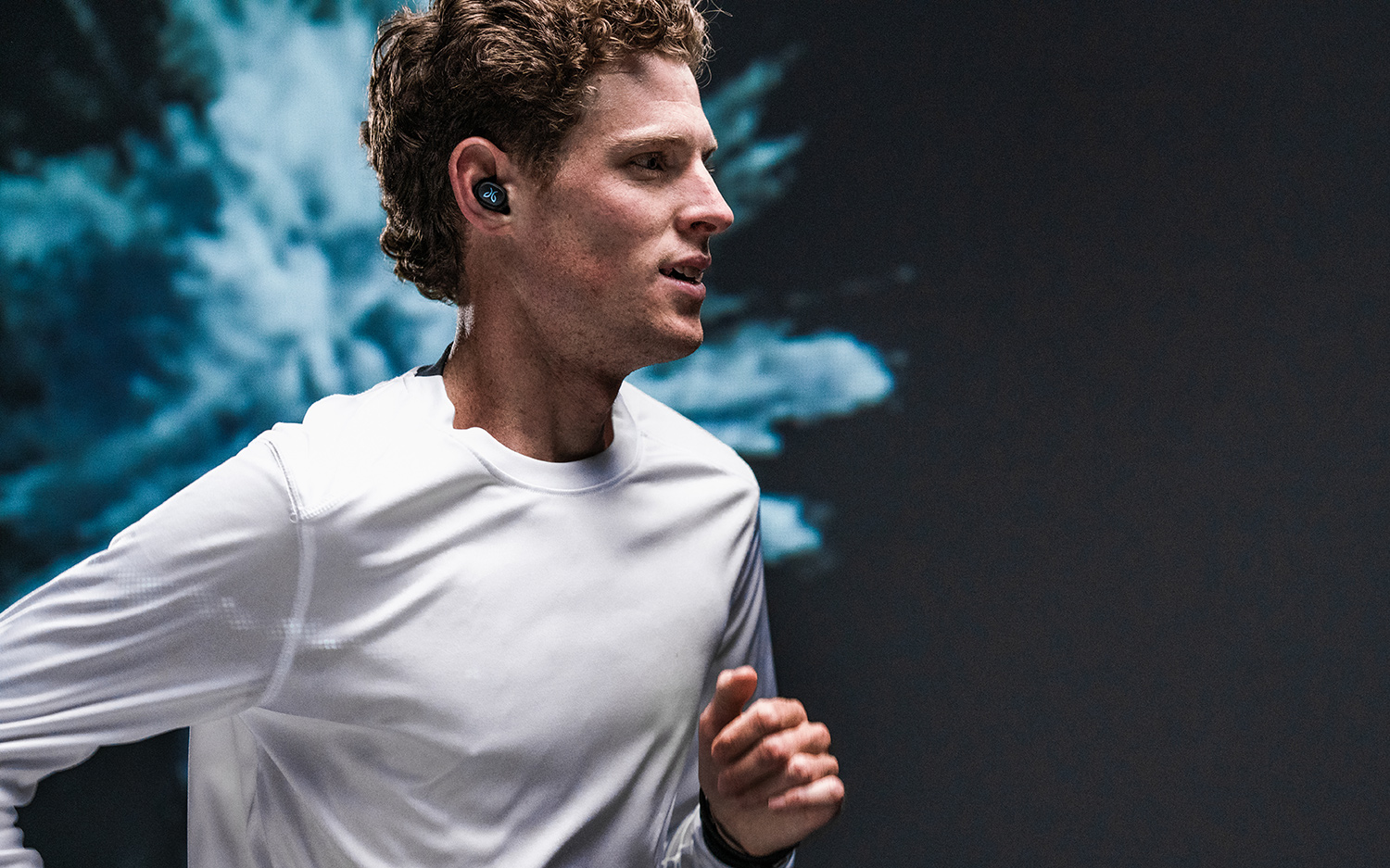 image or runner wearing Jaybird Vista truly wireless headphones