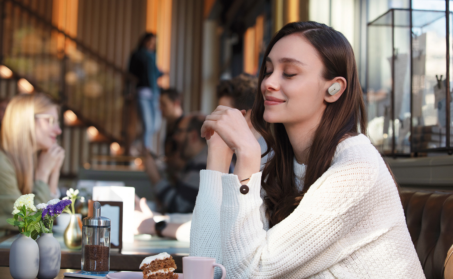 image of woman enjoying silence due to Truly Wireless headphones