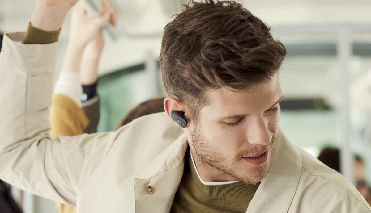image of men in transport with Sony WF-1000XM3 earbuds