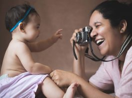 Mum photographing her baby