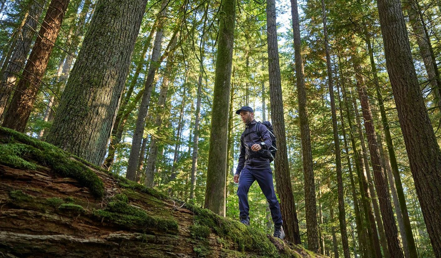 Image of guy in forest with GPS Garmin System